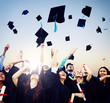 Cheerful Students Throwing Graduation Caps
