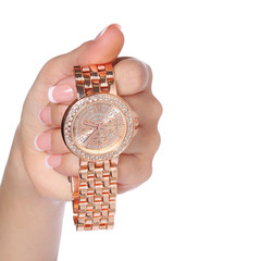 Gold Wrist Watches with Diamonds in Female Hand isolated