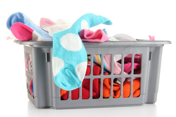 Plastic basket with socks isolated on white