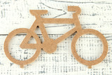 Decorative bicycle on wooden background