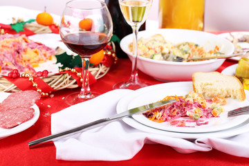 Table with festive dishes after feast close-up