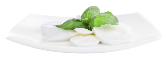 Tasty mozzarella cheese with basil on plate isolated on white