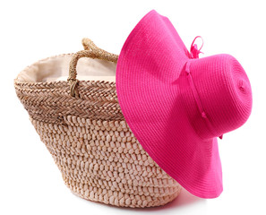 Wicker bag with hat, isolated on white