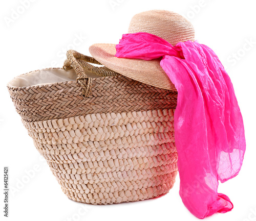 Wicker bag with hat and colorful scarf, isolated on white