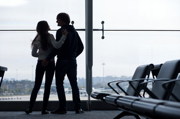 Silhouette of a couple at airport terminal