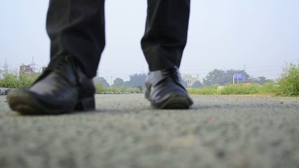 walking forward and backward feet on road