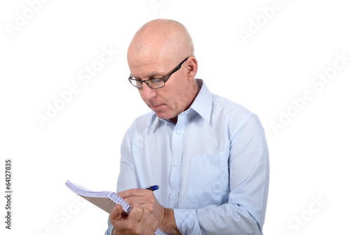 Man standing with a notepad