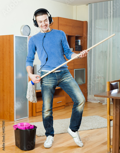 man  cleaning  in room