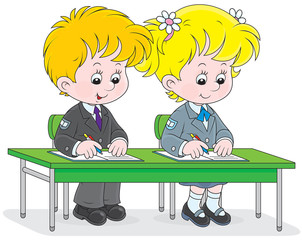 Schoolgirl and schoolboy write in exercise books
