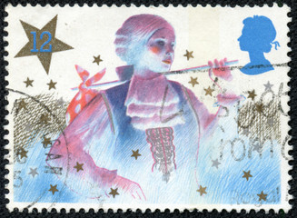 Stamp shows image of a Christmas pantomime character