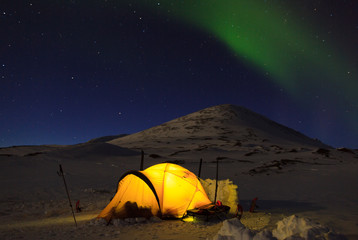 Aurora borealis, Northern Lights, over a tent in Lapland.