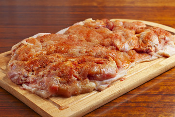 raw chicken piece with spices for the preparation