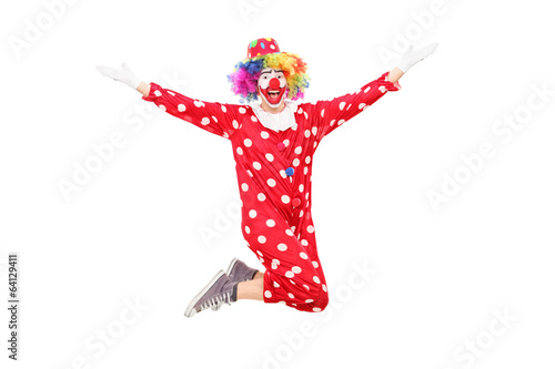 Male clown jumping out of joy