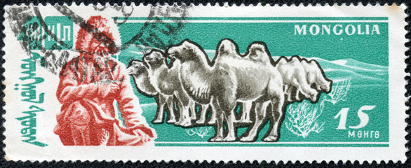 stamp features man in traditional cloth smoking pipe