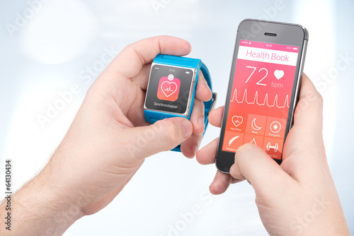Leinwanddruck Bild Data synchronization of health book between smartwatch and smartphone