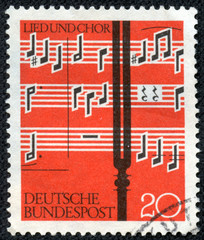 stamp printed in the Germany shows Notes and Tuning Fork