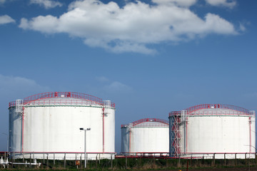 oil industry refinery tanks on field