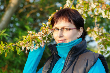 happy smiling middle age woman outdoor with tree