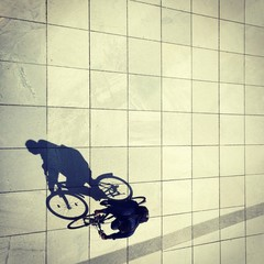 Cycling man and his shadow in Berlin