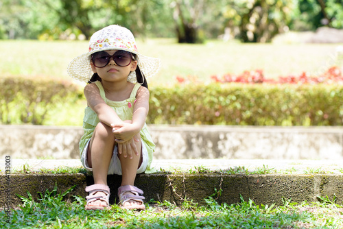 Little kid sitting in the park