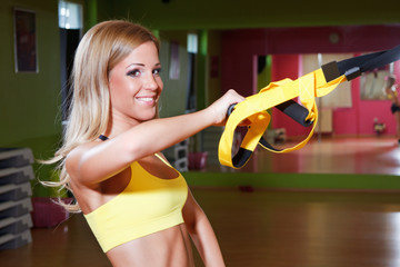 Beautiful young woman working out in the gym