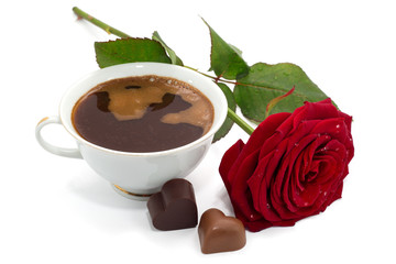 Beautiful red rose, cup of coffee and chocolate candies