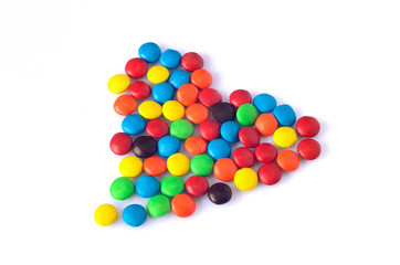 Colourful candy arranged in heart shape