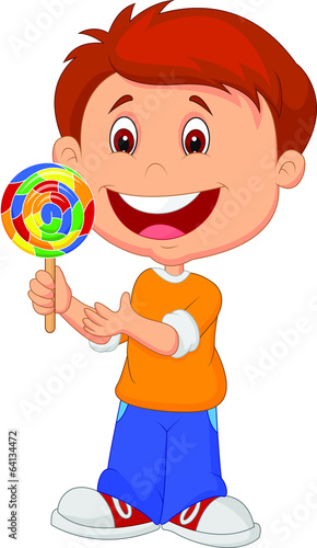 Little boy holding lollipop candy