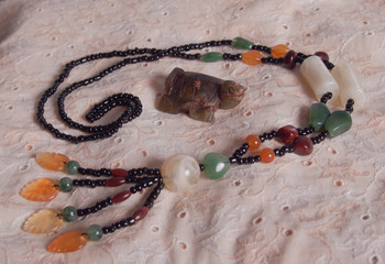 Still life with a turtle and a necklace of opals