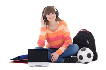 teenage girl in headphones sitting with laptop