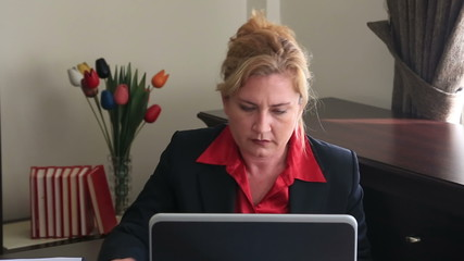 Businesswoman having neck pain