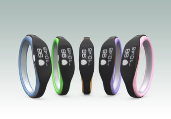 Colorful smart wristbands on gray background