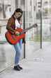 Girl playing guitar in the city