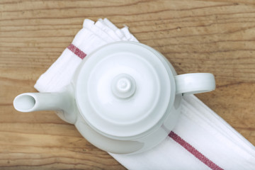 White Teapot on wooden background
