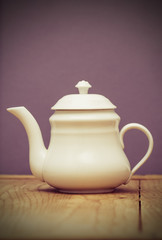 White Teapot on wooden table