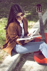 Girl reading in urban scene