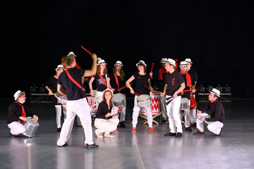 Rehearsal of musical group under leadership of art director