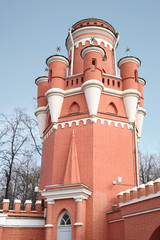 The tower of red brick Petroff Palace in Moscow.