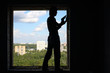 Silhouette of a worker with a spatula in his hand
