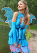 Beautiful girl in blue fairy costume with wings