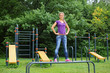 Beautiful girl standing on the parallel bars