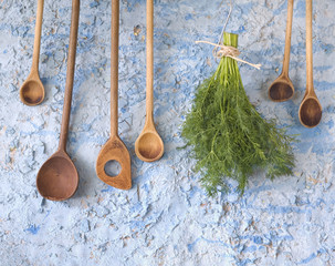 vintage wooden spoons with dill herbs, free copy space
