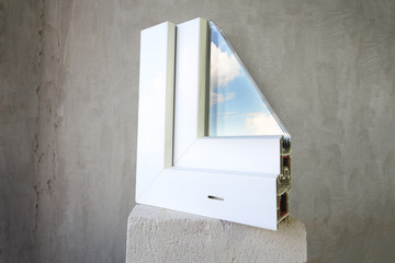 Sample PVC window stands on a concrete block