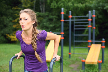 Young beautiful girl with a plait doing exercise