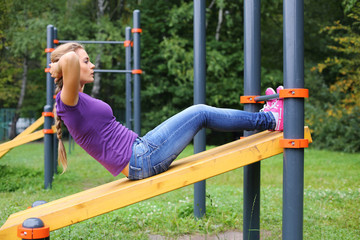A young girl doing abdominal crunches