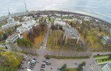 View from unmanned quadrocopter on pavilions with car parking poster