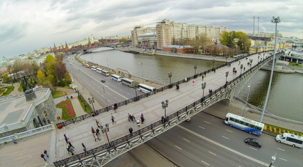 View from unmanned quadrocopter to peopole walking