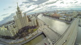 View from unmanned quadrocopter to famous skyscrape and bridge poster