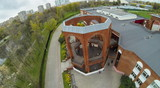 View from unmanned quadrocopter on entrance to brick building poster