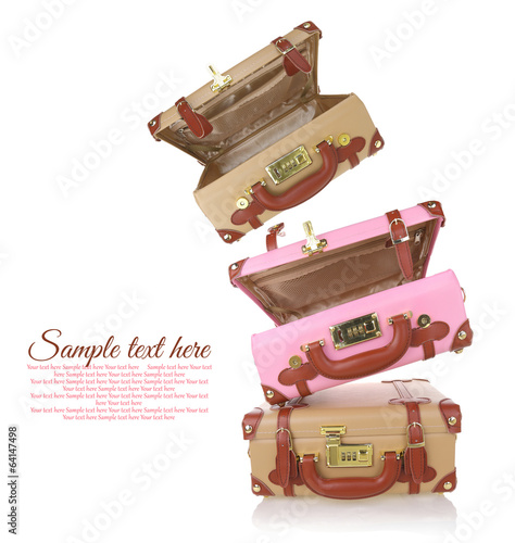 Stack of travel suitcases with copy-space isolated on white